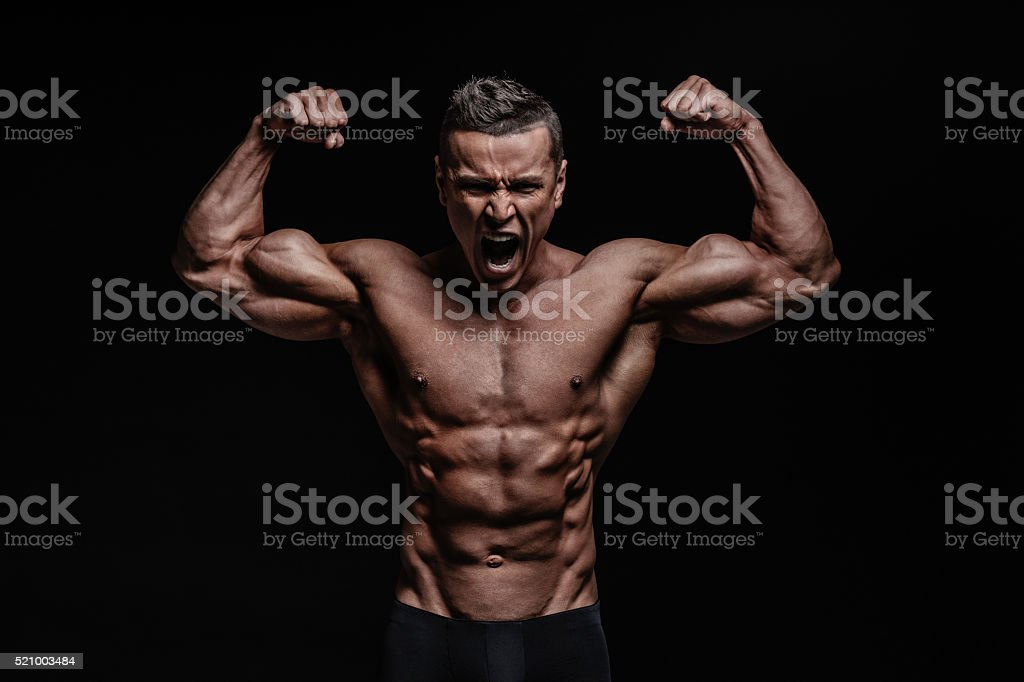 Muscular male posing stock photo
