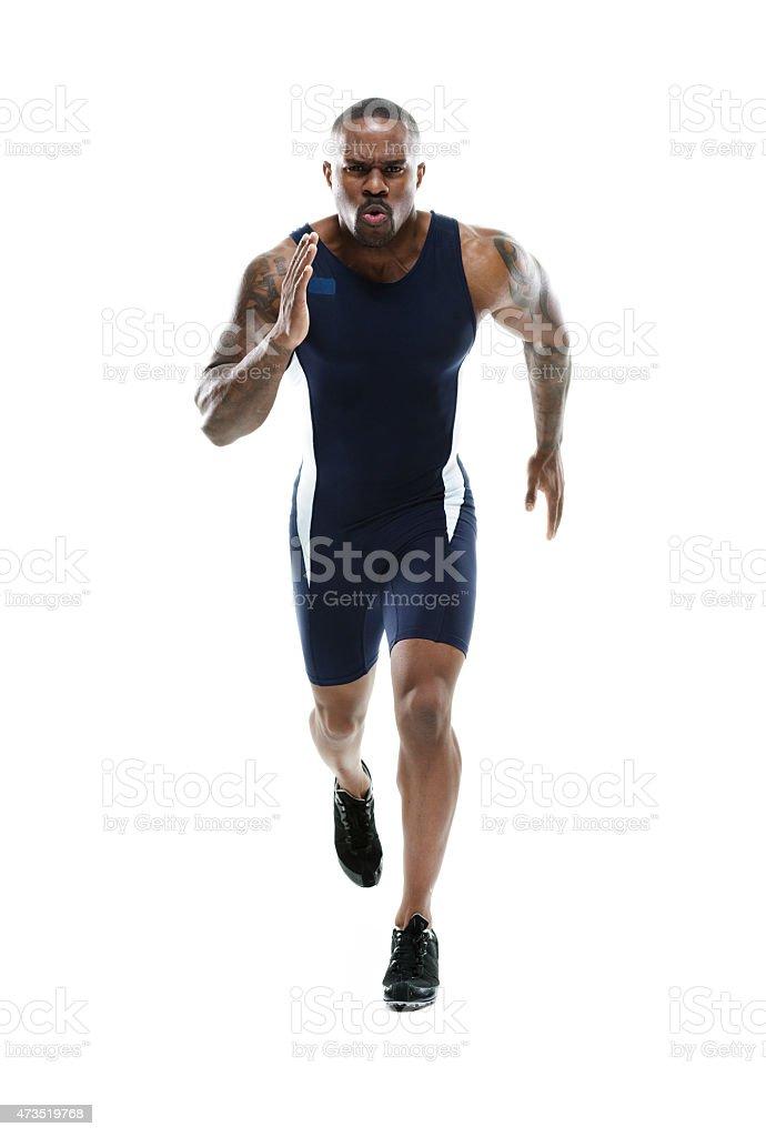 Muscular male runner running stock photo