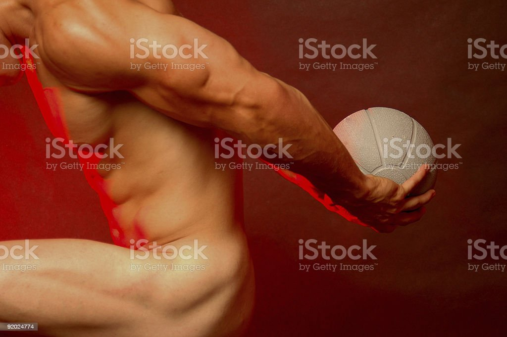 muscular male with sports ball royalty-free stock photo
