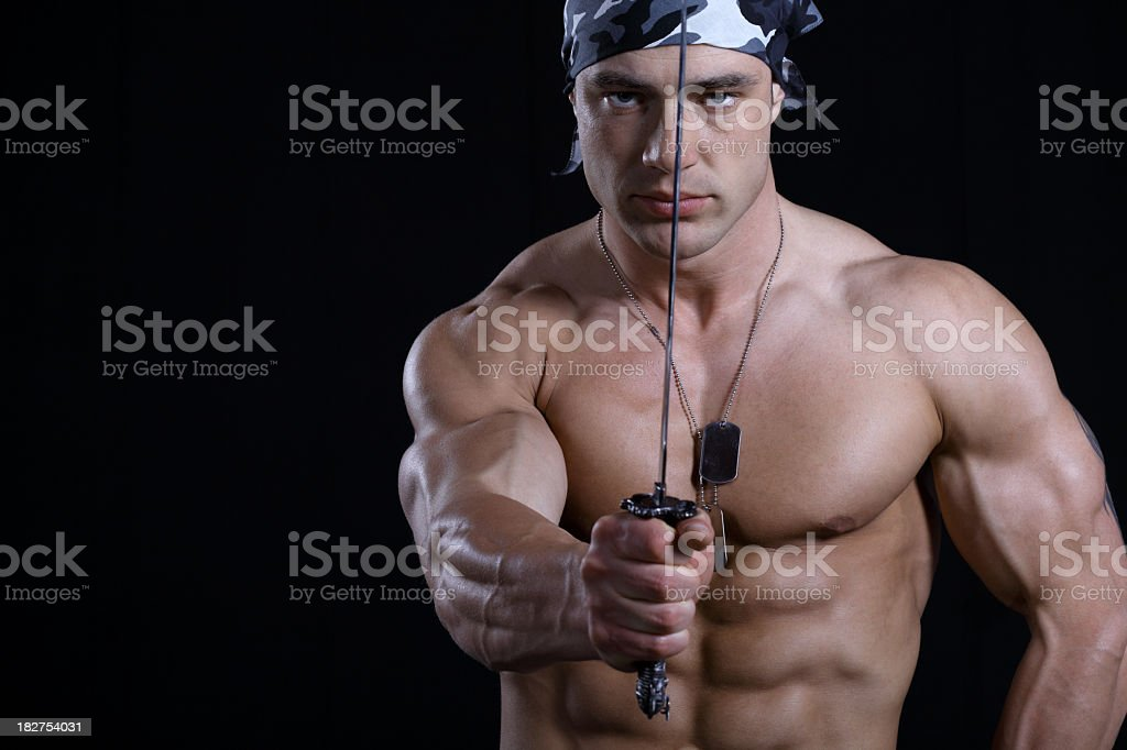 Muscular male with steel looking at camera royalty-free stock photo