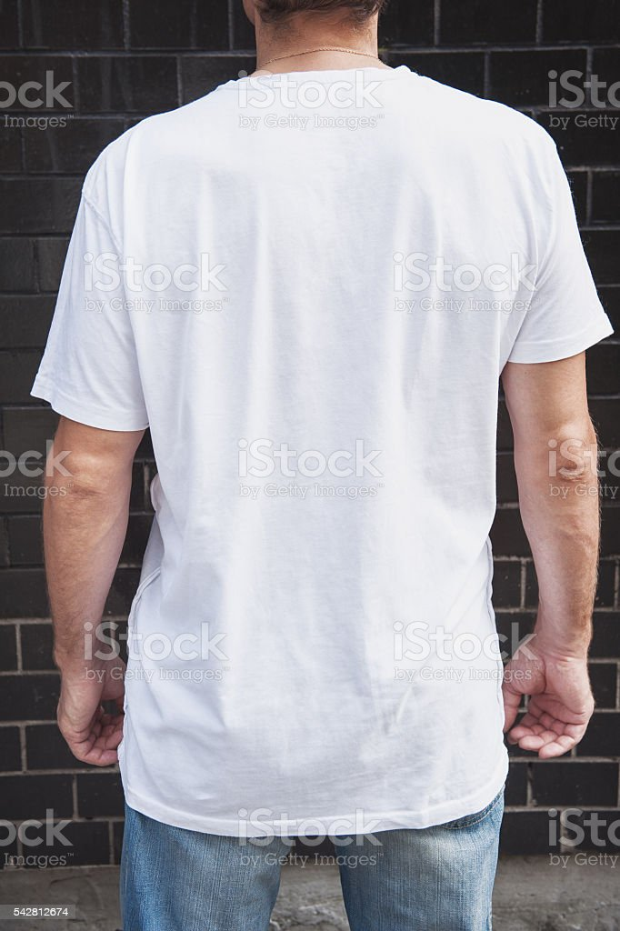 Muscular man back wearing white blank t-shirt stock photo