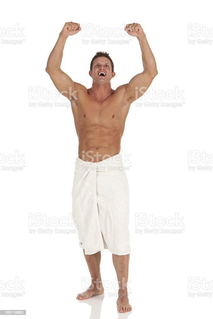 muscular man cheering with arms raised stock photo  u0026 more