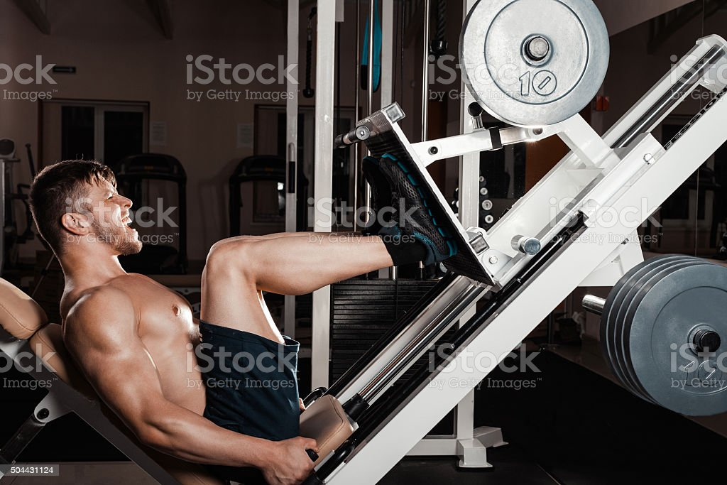 muscular Man Doing Heavy Exercise stock photo