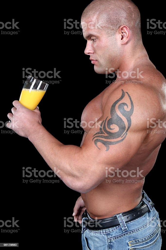 Muscular man drinking juice royalty-free stock photo
