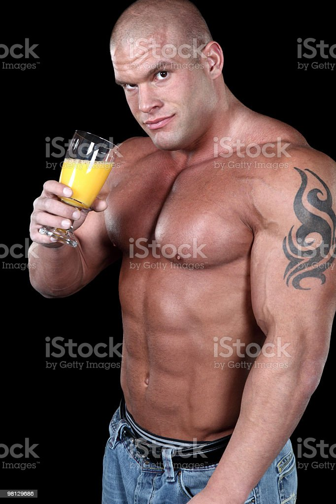 Muscular man drinking juice royalty-free stock photo
