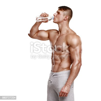 istock Muscular man drinking water, isolated on white background 583727204
