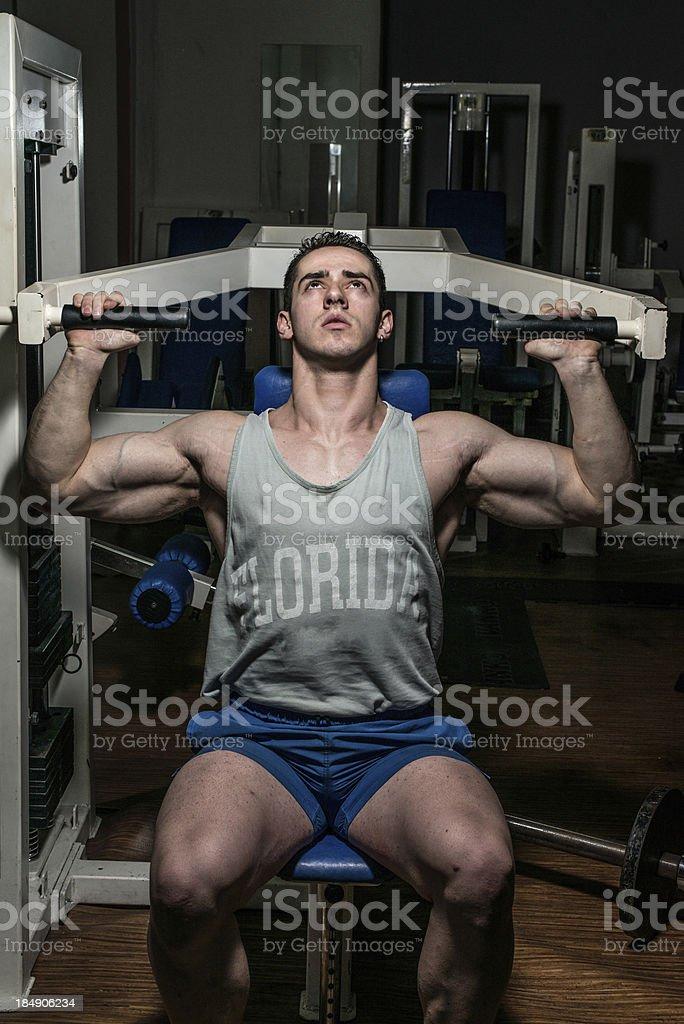 muscular man exercising in Gym stock photo