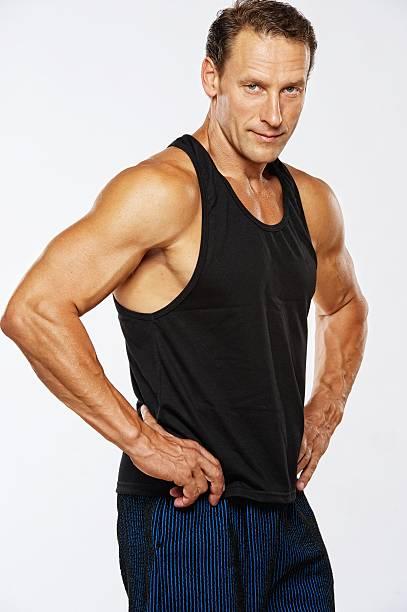 Muscular man facing the camera stock photo