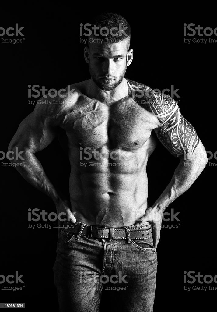 Muscular man - half-length, black and white photo stock photo