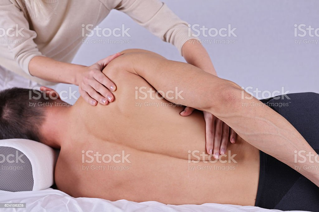Muscular Man having sport massage. Acupressure, Chiropractic, osteopathy stock photo