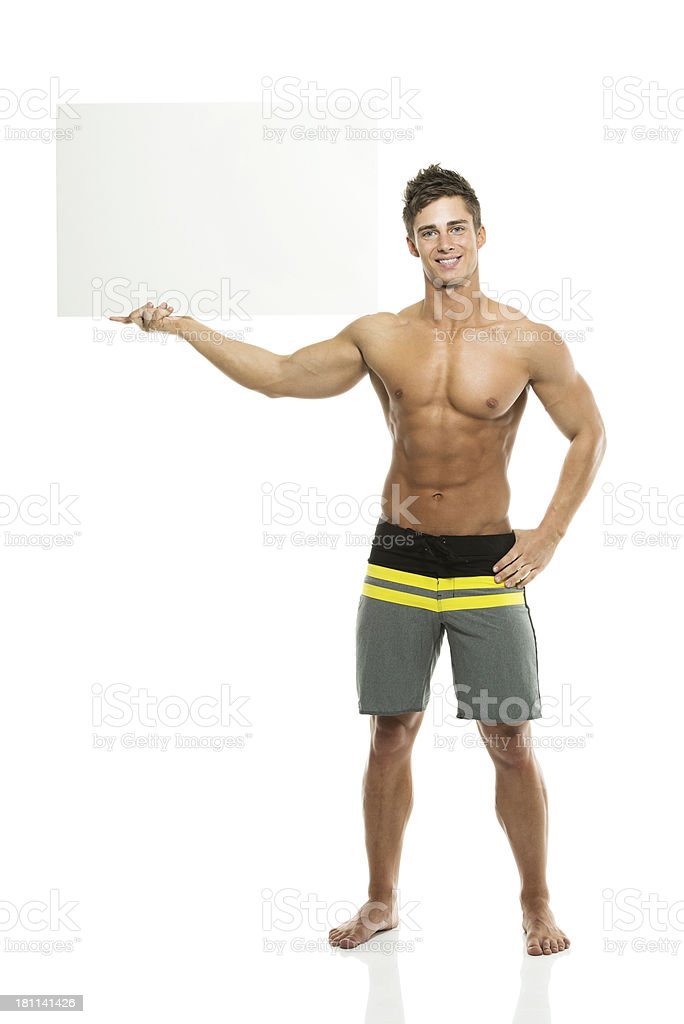 Muscular man holding a placard royalty-free stock photo