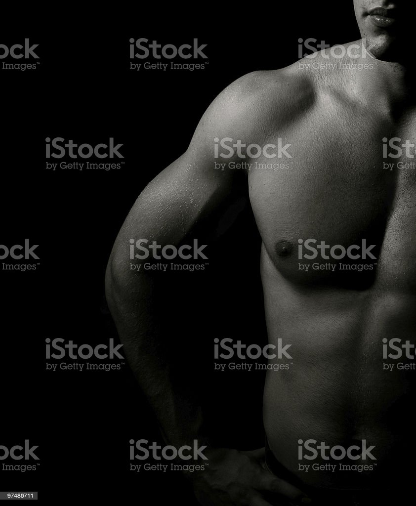 Muscular man in black and white shadow on a black background royalty-free stock photo