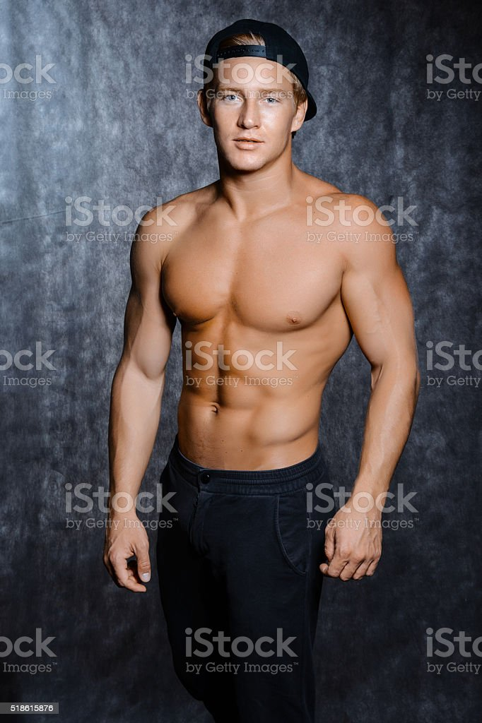 Muscular man  in   cap with a naked torso stock photo
