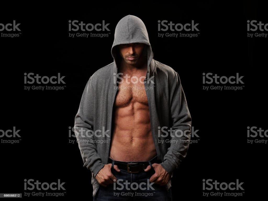 Muscular man in gray hoodie royalty-free stock photo