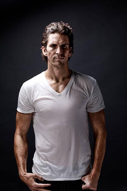 Muscular man looking at camera stock photo