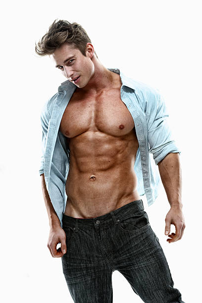 Muscular man looking at camera Muscular man looking at camerahttp://www.twodozendesign.info/i/1.png fully unbuttoned stock pictures, royalty-free photos & images
