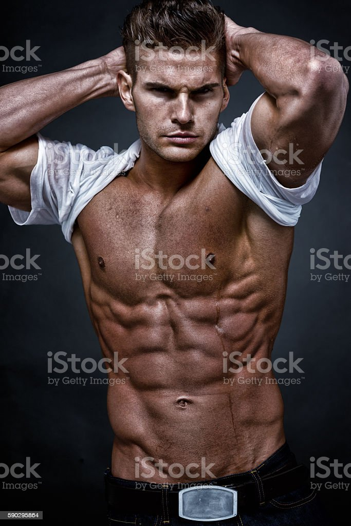 Muscular man looking at camera royaltyfri bildbanksbilder