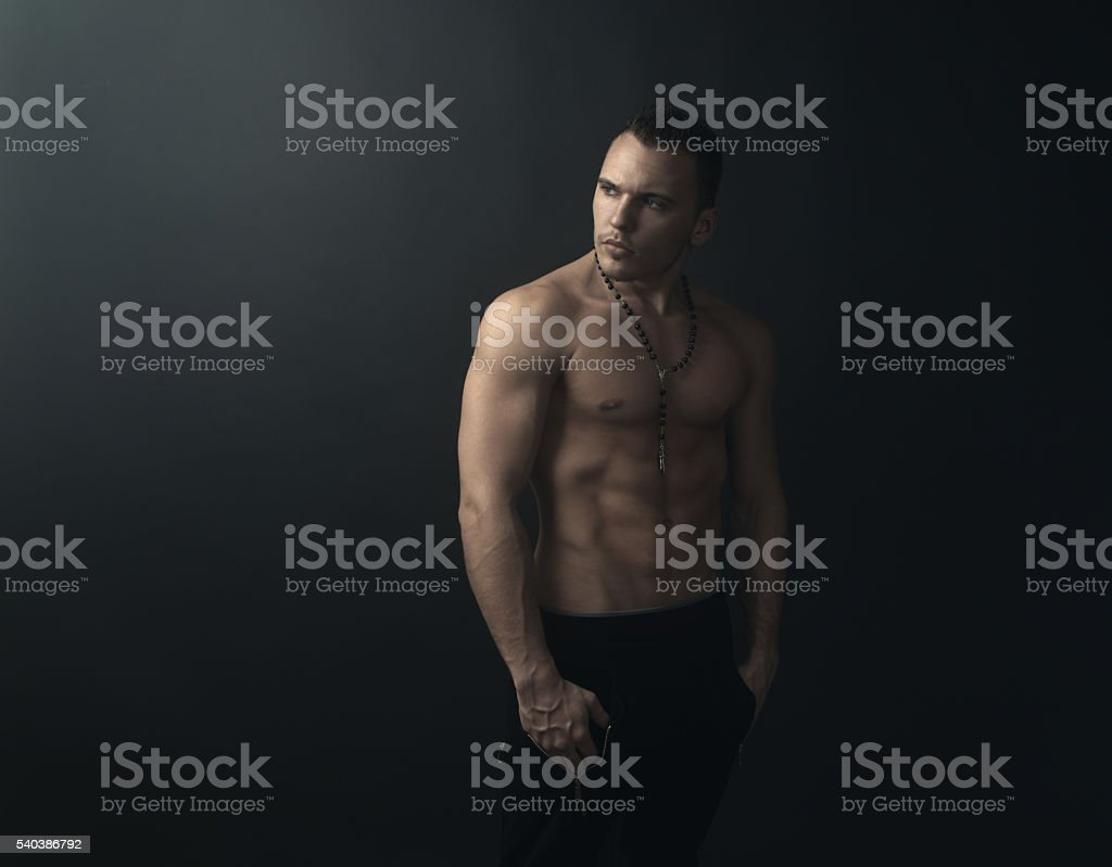 muscular man looks back stock photo