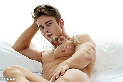 Muscular Man Lying On Bed Stock Photo & More Pictures of