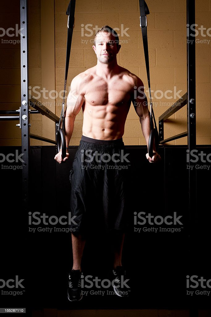 Muscular Man On Gymnastic Rings royalty-free stock photo