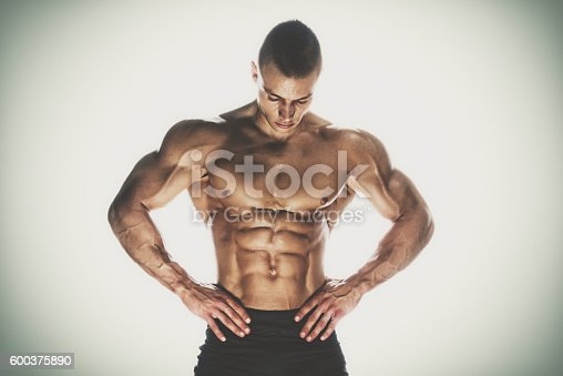 618209684 istock photo Muscular Man 600375890