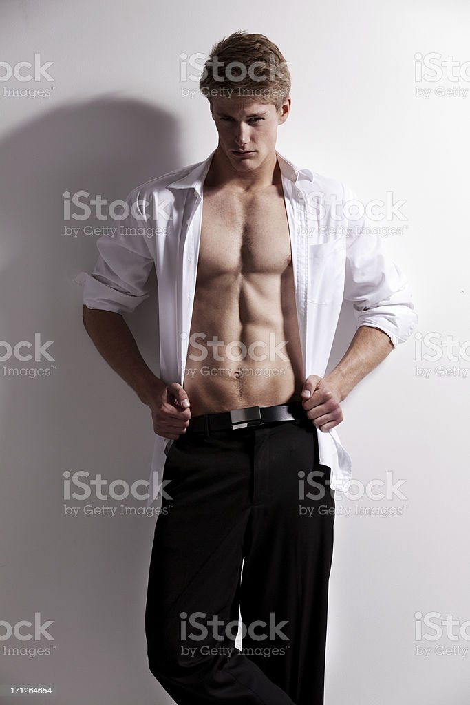 Muscular man posing stock photo