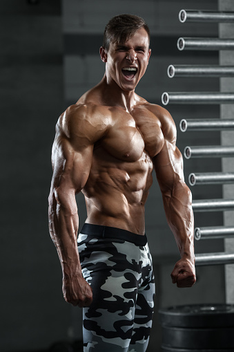 Strong Man Bodybuilder In Gym Corporate Pose With Naked