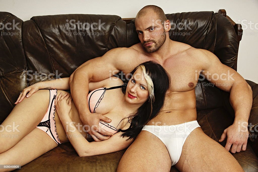 Muscular man siting with his girl stock photo