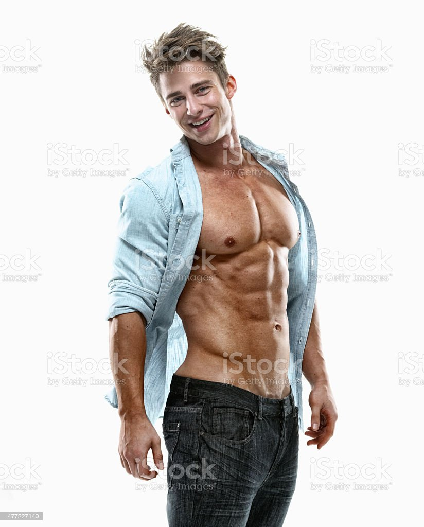 Muscular man standing and looking at camera stock photo