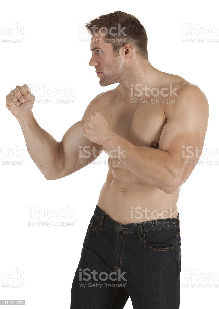 Muscular man standing in fighting pose royalty-free stock photo