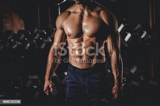 istock Muscular Man Standing In The Gym 998035336
