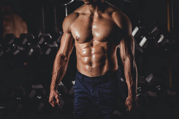 Muscular Man Standing In The Gym Strong Muscular Men Standing At The Gym abdominal muscle stock pictures, royalty-free photos & images