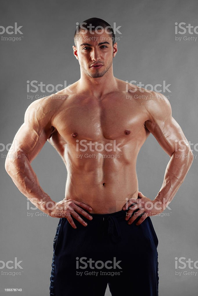 Muscular man standing with hands on hip royalty-free stock photo