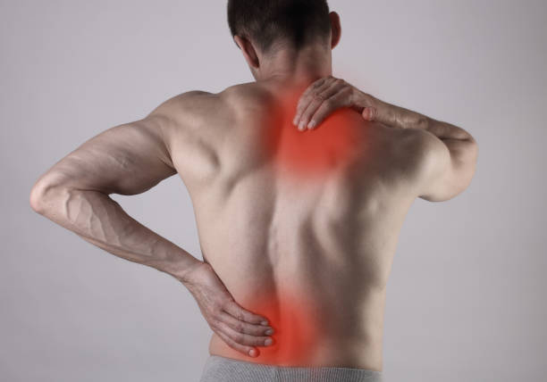 muscular man suffering from back and neck pain. incorrect sitting posture problems muscle spasm, rheumatism. pain relief, ,chiropractic concept. sport exercising injury - infiammazione foto e immagini stock