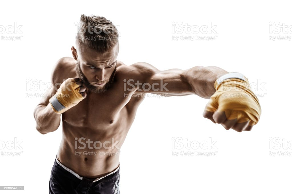Muscular man throwing a fierce and powerful punch – Foto