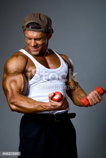 618638418istockphoto Muscular man training with small dumbbells 846329950