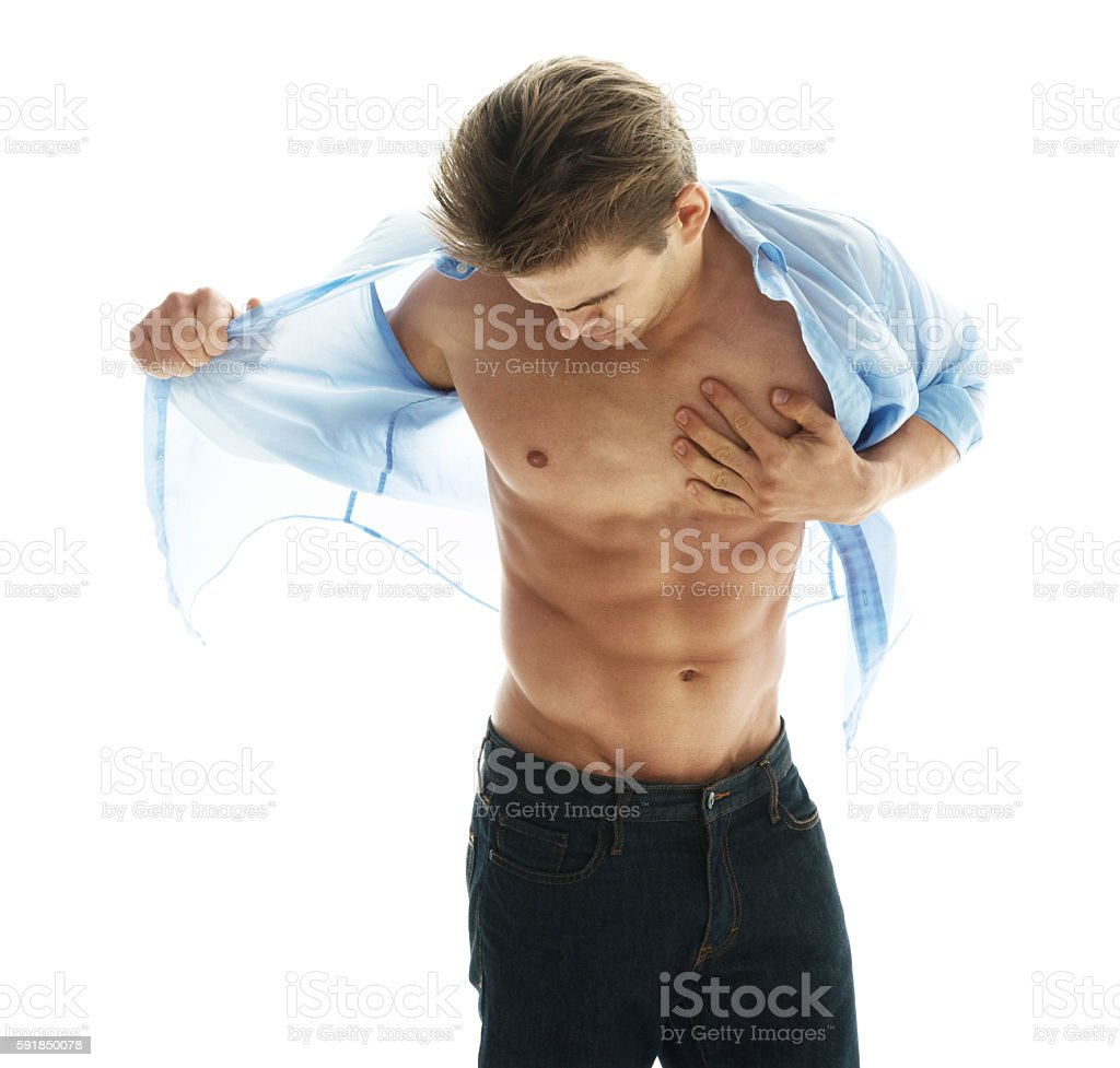 Muscular man undressing stock photo