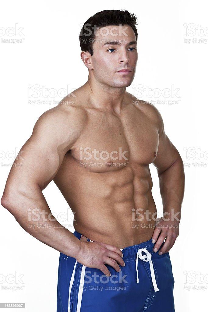 Muscular man wearing board shorts royalty-free stock photo