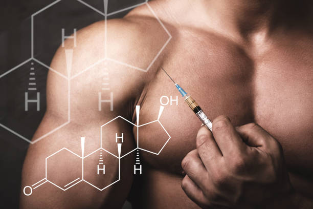 muscular man with a syringe in his hand and testosterone formula. - esteróides imagens e fotografias de stock