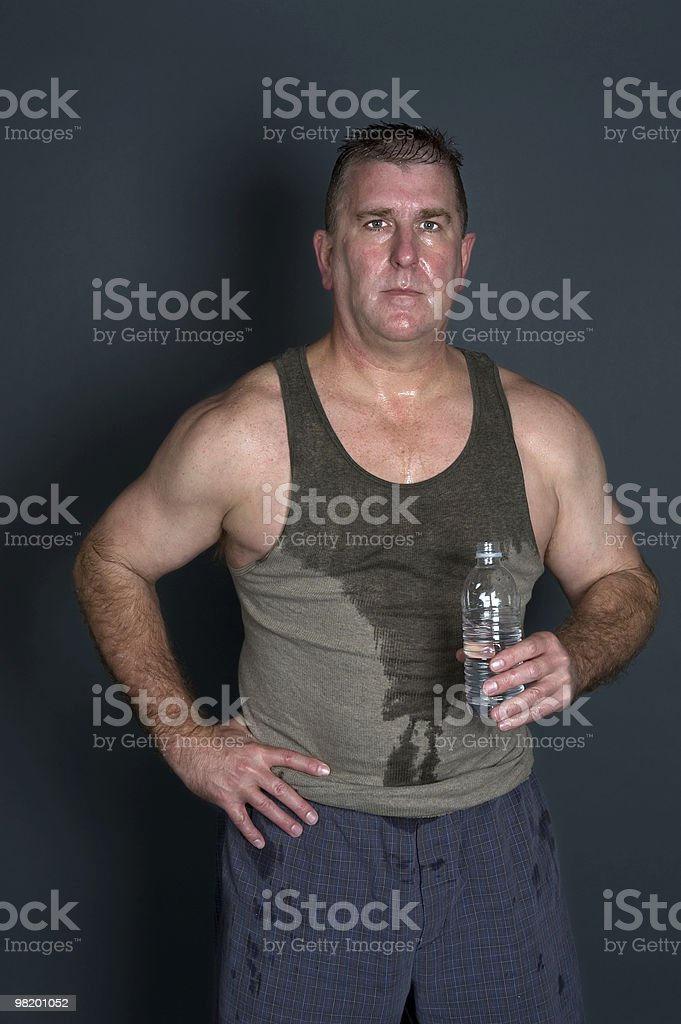 Muscular man with bottled water stock photo