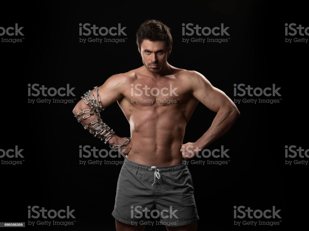 Muscular man with chain on arm 免版稅 stock photo
