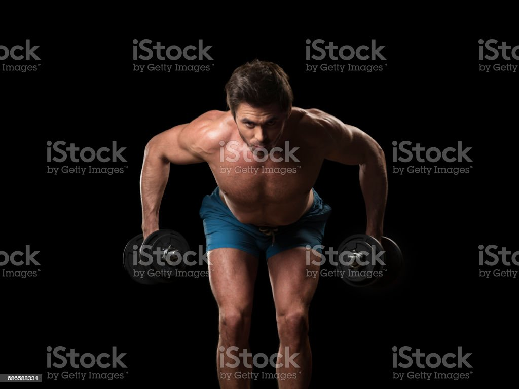 Muscular man with dumbbells photo libre de droits