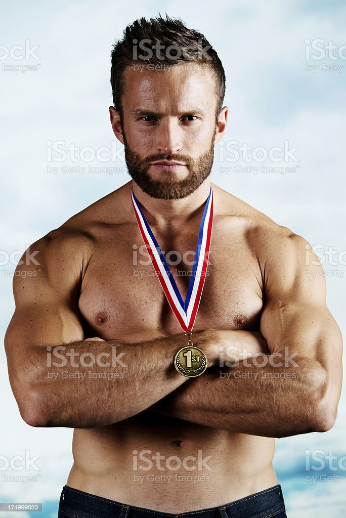 Muscular man with gold medal royalty-free stock photo