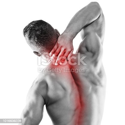 Muscular man with pain in his neck over white background