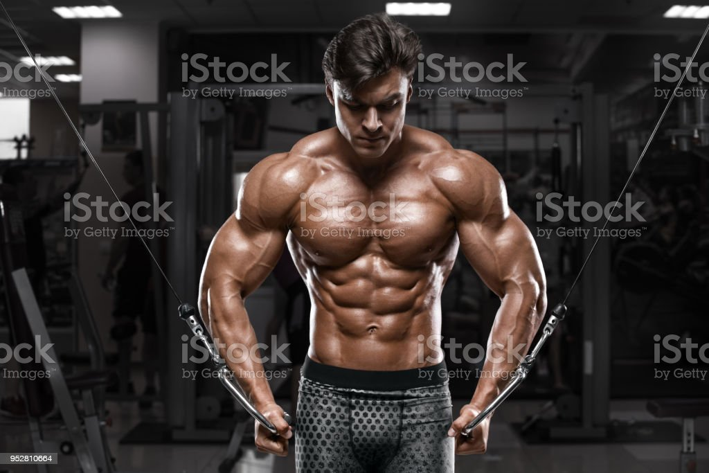 Muscular Man Working Out In Gym With Tire Strong Male