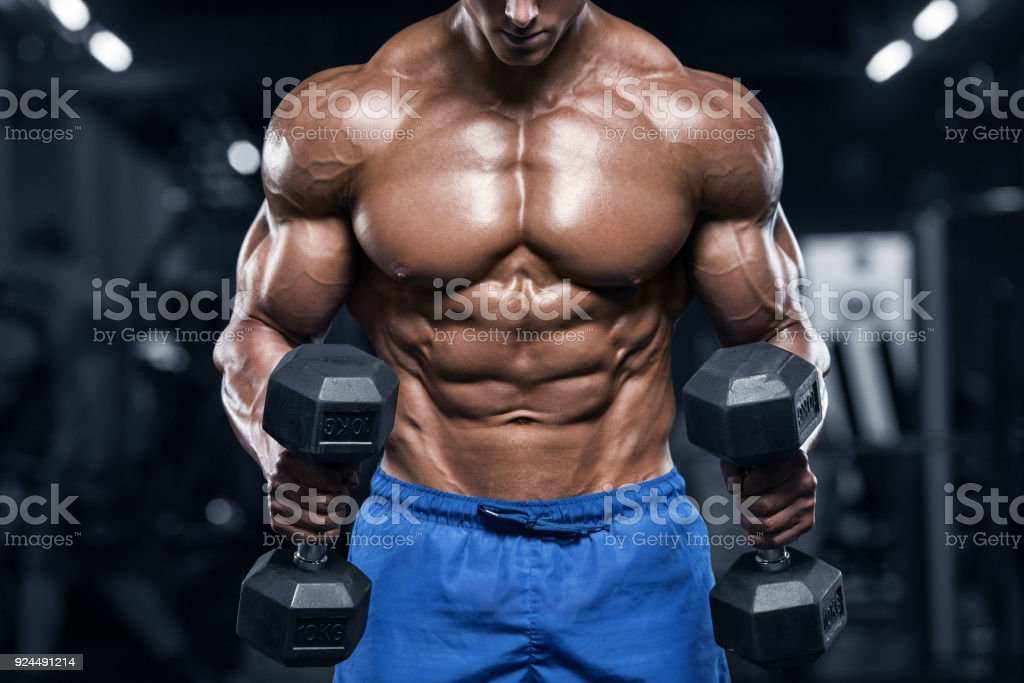 Muscular man working out in gym, strong male torso abs - foto stock