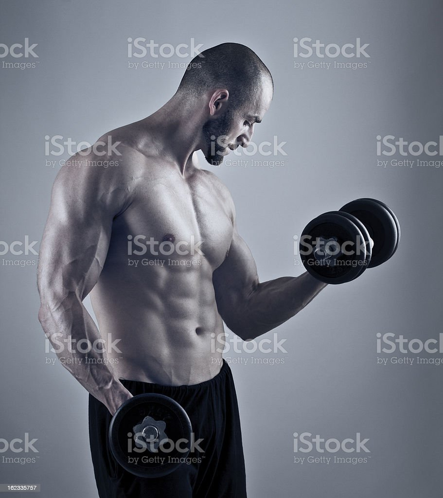 Muscular man workout with dumbbells royalty-free stock photo