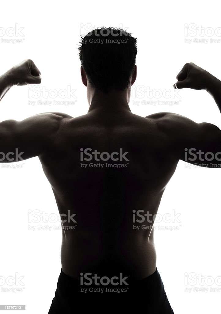 Muscular man's back in silhouette royalty-free stock photo