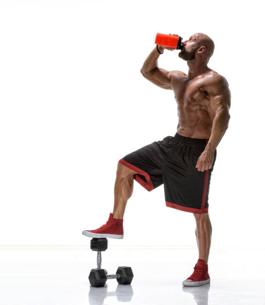 Muscular Men Drink Protein Shake stock photo