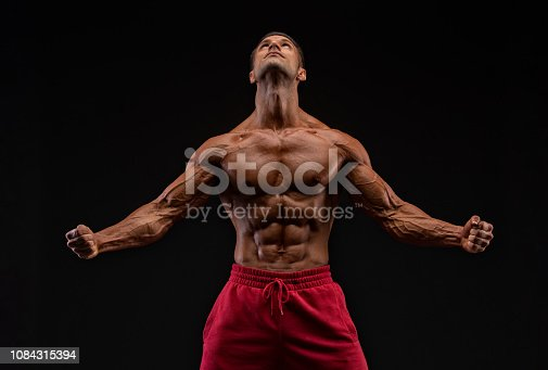 Handsome Athletic Man Flexing Muscles
